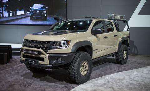 Land vehicle, Vehicle, Car, Automotive tire, Tire, Bumper, Motor vehicle, Pickup truck, Auto show, Automotive exterior,