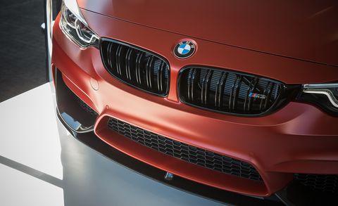 Car, Grille, Vehicle, Motor vehicle, Automotive design, Personal luxury car, Bmw, Red, Automotive exterior, Bumper,