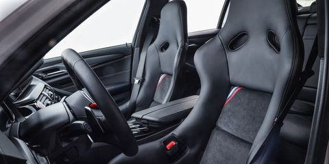 Land vehicle, Vehicle, Car, Steering wheel, Automotive design, Car seat, Steering part, Luxury vehicle, Car seat cover, Center console,