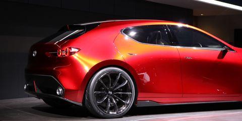 Land vehicle, Vehicle, Car, Automotive design, Auto show, Mid-size car, Sports car, Concept car, Automotive lighting, Luxury vehicle,