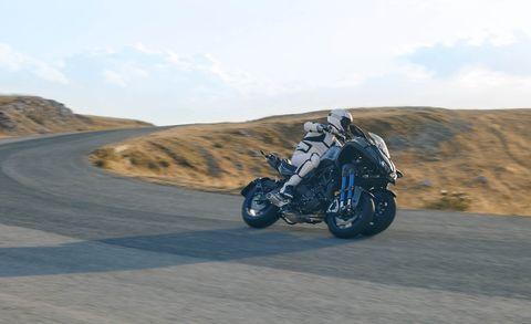 Motorcycle, Vehicle, Mode of transport, Motorcycling, Automotive tire, Landscape, Sand, Adventure, Road, Automotive wheel system,