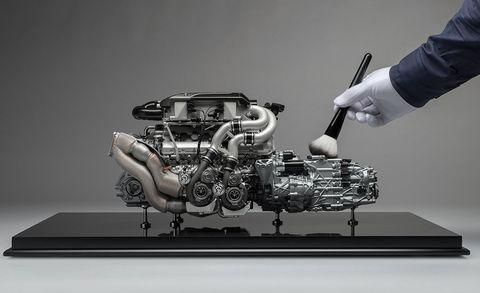 Automotive design, Engine, Electronics, Auto part, Technology, Hand, Vehicle, Machine, Car, Miniature,