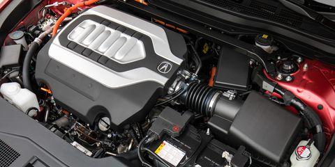 Land vehicle, Vehicle, Car, Engine, Auto part, Mid-size car, Family car, Automotive engine part,