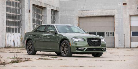 Land vehicle, Vehicle, Car, Luxury vehicle, Chrysler 300, Motor vehicle, Sedan, Automotive design, Rim, Mid-size car,