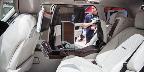 Vehicle, Car, Head restraint, Car seat cover, Car seat, Luxury vehicle, Automotive design, Range rover, Family car, Sport utility vehicle,