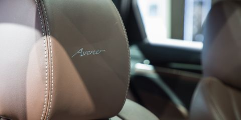 Head restraint, Car seat cover, Car seat, Vehicle, Auto part, Car, Automotive design, Steering wheel, Steering part, Seat belt,