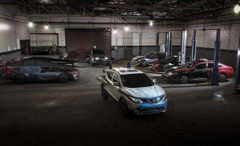 Vehicle, Car, Automotive design, Parking, Car dealership, Parking lot, Family car, City, Sport utility vehicle, Building,