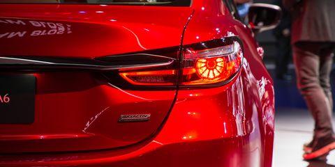 Land vehicle, Vehicle, Car, Automotive design, Mid-size car, Auto show, Automotive lighting, Motor vehicle, Full-size car, Compact car,