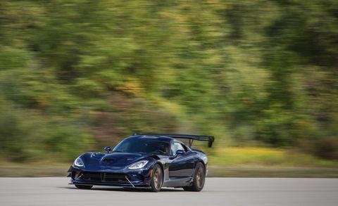 Land vehicle, Vehicle, Car, Sports car, Supercar, Automotive design, Coupé, Performance car, Rim, Wheel,