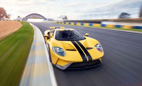 Land vehicle, Vehicle, Supercar, Sports car, Car, Performance car, Yellow, Automotive design, Race car, Sports car racing,