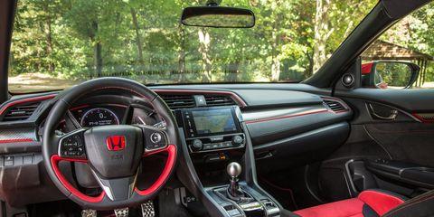 Land vehicle, Vehicle, Car, Center console, Motor vehicle, Steering wheel, Automotive design, Performance car, Personal luxury car, Luxury vehicle,