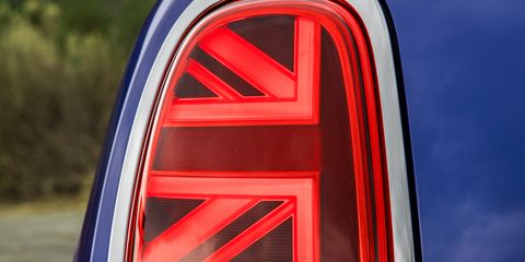 Automotive lighting, Red, Automotive tail & brake light, Automotive design, Car, Vehicle, Wheel,
