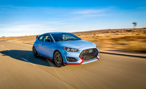 Land vehicle, Vehicle, Car, Automotive design, Sky, Mid-size car, Sports car, Landscape, Automotive wheel system, Hot hatch,