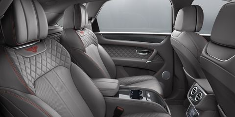 Land vehicle, Vehicle, Car, Luxury vehicle, Car seat cover, Personal luxury car, Vehicle door, Automotive design, Head restraint, Center console,