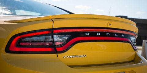 Land vehicle, Vehicle, Car, Automotive design, Yellow, Performance car, Automotive exterior, Mid-size car, Automotive lighting, Luxury vehicle,