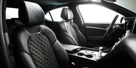Land vehicle, Vehicle, Car, Car seat cover, Automotive design, Mid-size car, Car seat, Luxury vehicle, Center console, Family car,