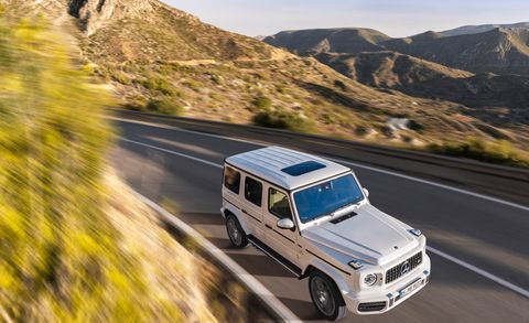 Land vehicle, Car, Vehicle, Mercedes-benz g-class, Sport utility vehicle, Automotive tire, Road trip, Off-roading, Road, Mountain,