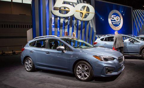 Land vehicle, Vehicle, Car, Auto show, Motor vehicle, Mid-size car, Subaru, Full-size car, Automotive design, Rim,
