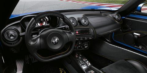 Land vehicle, Vehicle, Car, Steering wheel, Center console, Motor vehicle, Steering part, Vehicle audio, Automotive design, Design,