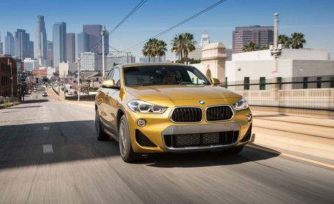 Land vehicle, Vehicle, Car, Motor vehicle, Automotive design, Bmw, Performance car, Yellow, Personal luxury car, Rim,