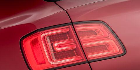 Land vehicle, Vehicle, Car, Automotive lighting, Automotive design, Automotive tail & brake light, Luxury vehicle, Light, Personal luxury car, Trunk,