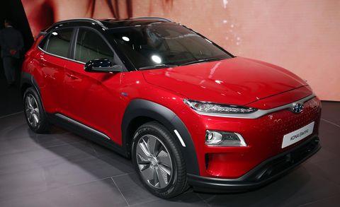 Land vehicle, Vehicle, Car, Motor vehicle, Automotive design, Red, Alloy wheel, Automotive tire, Rim, Mid-size car,