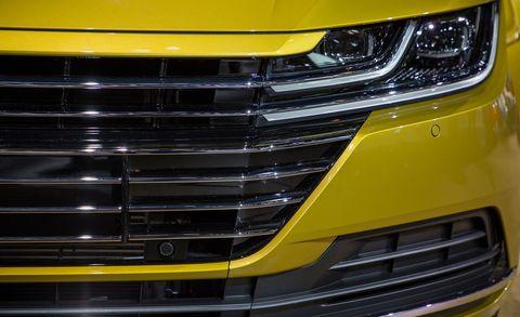 Grille, Vehicle, Car, Automotive exterior, Headlamp, Bumper, Motor vehicle, Yellow, Automotive design, Auto show,