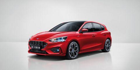 Land vehicle, Vehicle, Car, Automotive design, Red, Mid-size car, Rim, Hatchback, Compact car, Automotive wheel system,