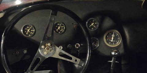 Vehicle, Car, Steering part, Steering wheel, Auto part, Wheel, Gauge, Rim, Subcompact car, Classic car,