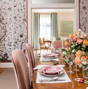 dining room, pink floral wallpaper, wooden oval table with pink velvet dining chairs
