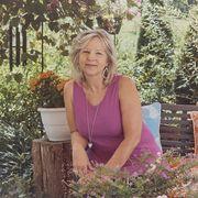 A woman sitting in her backyard
