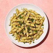 pasta with herbs on a pink background