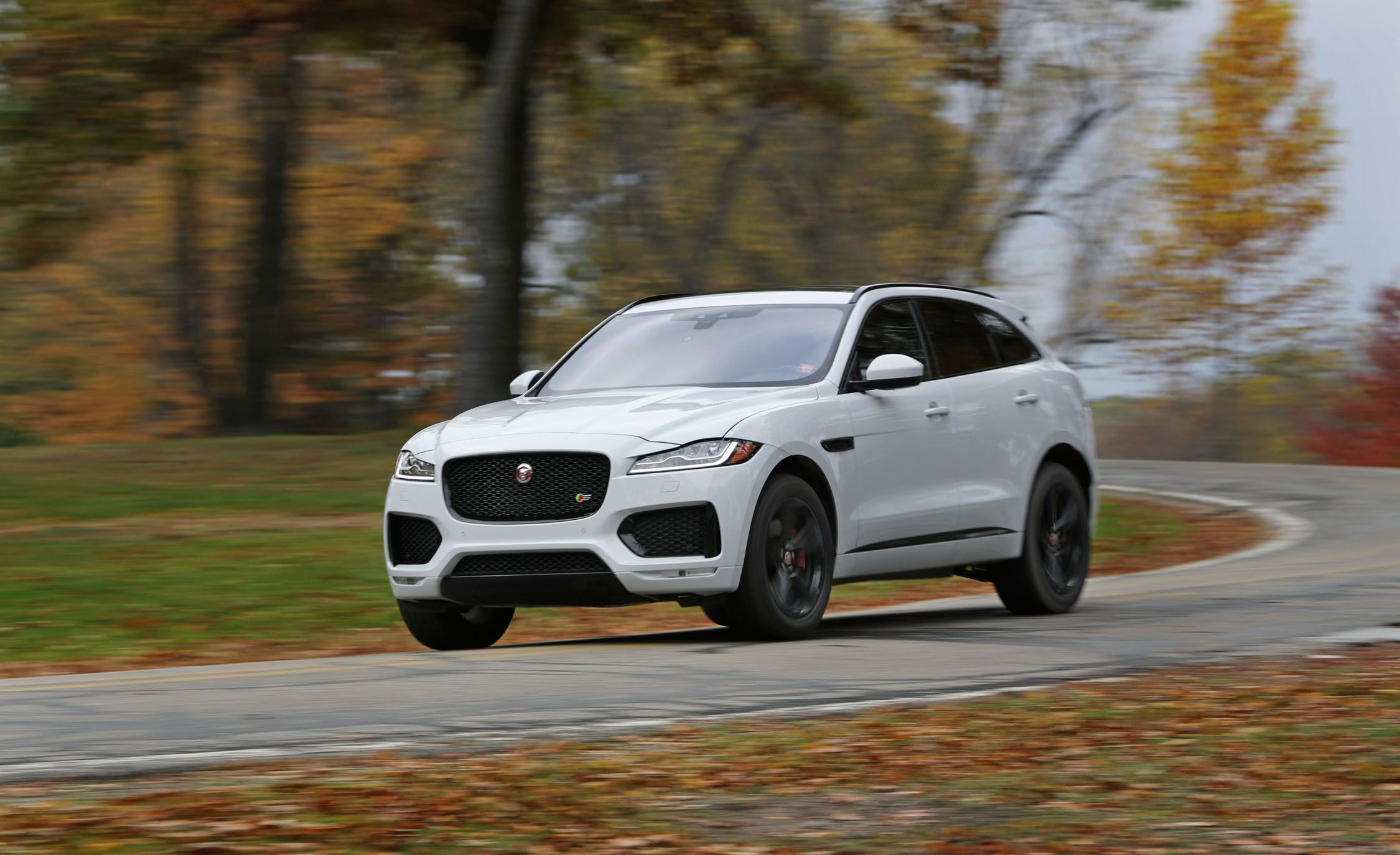 jaguar f pace reviews jaguar f pace price photos and specs car and driver. Black Bedroom Furniture Sets. Home Design Ideas