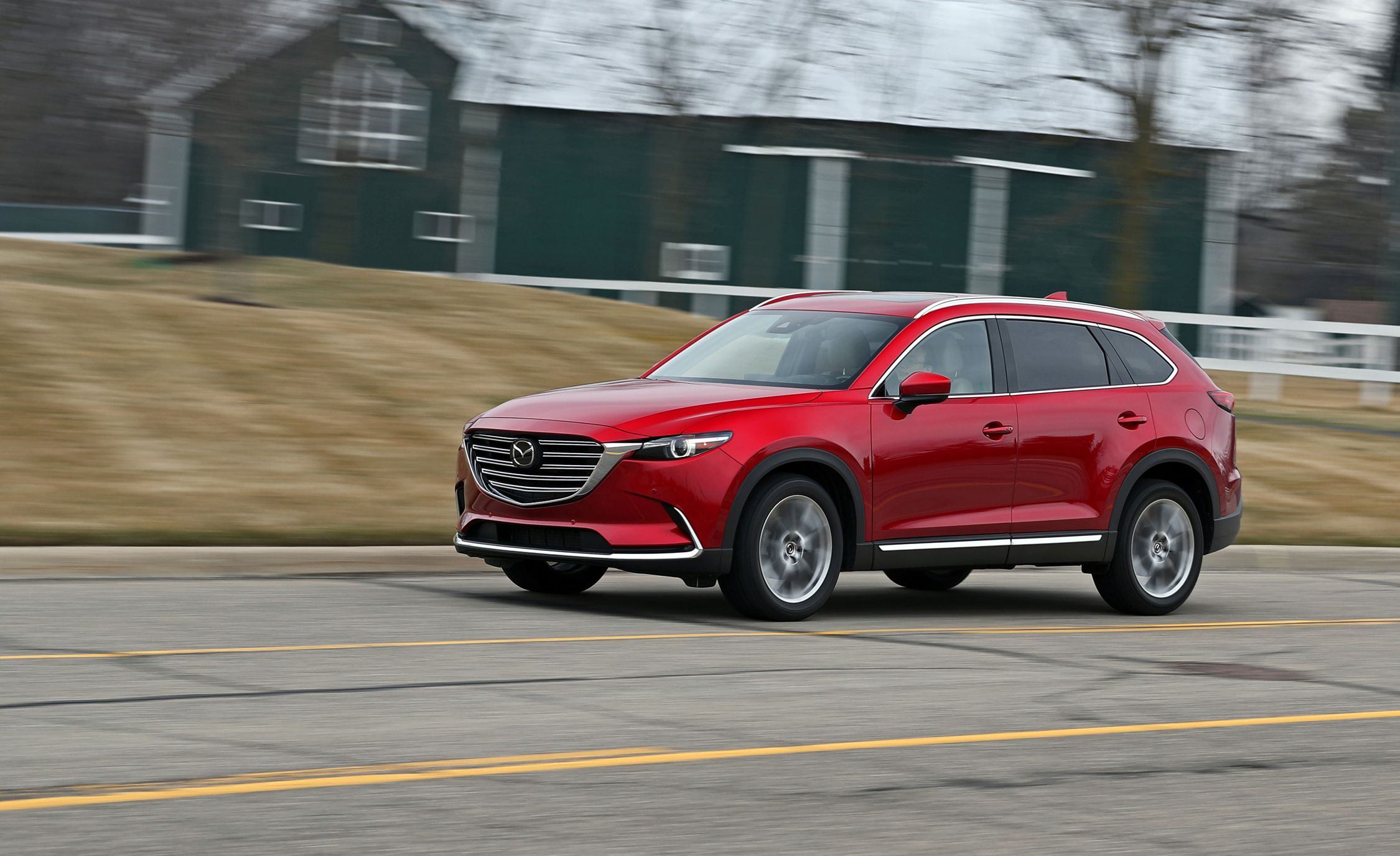 Mazda CX-9 Reviews | Mazda CX-9 Price, Photos, and Specs | Car and Driver