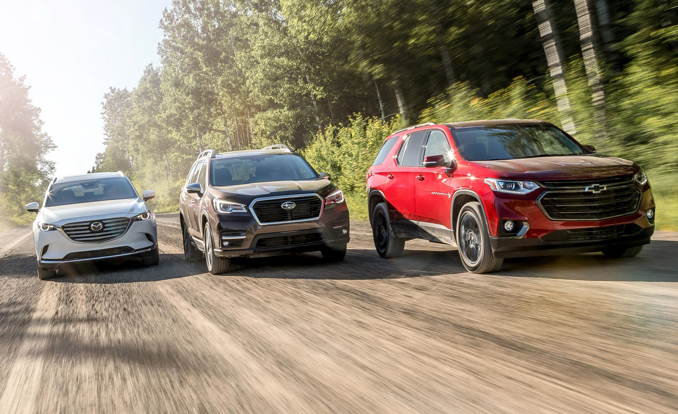 Three-Row SUVs Compared: Subaru Ascent and Chevrolet Traverse Take on Our Reigning Champ, the Mazda CX-9
