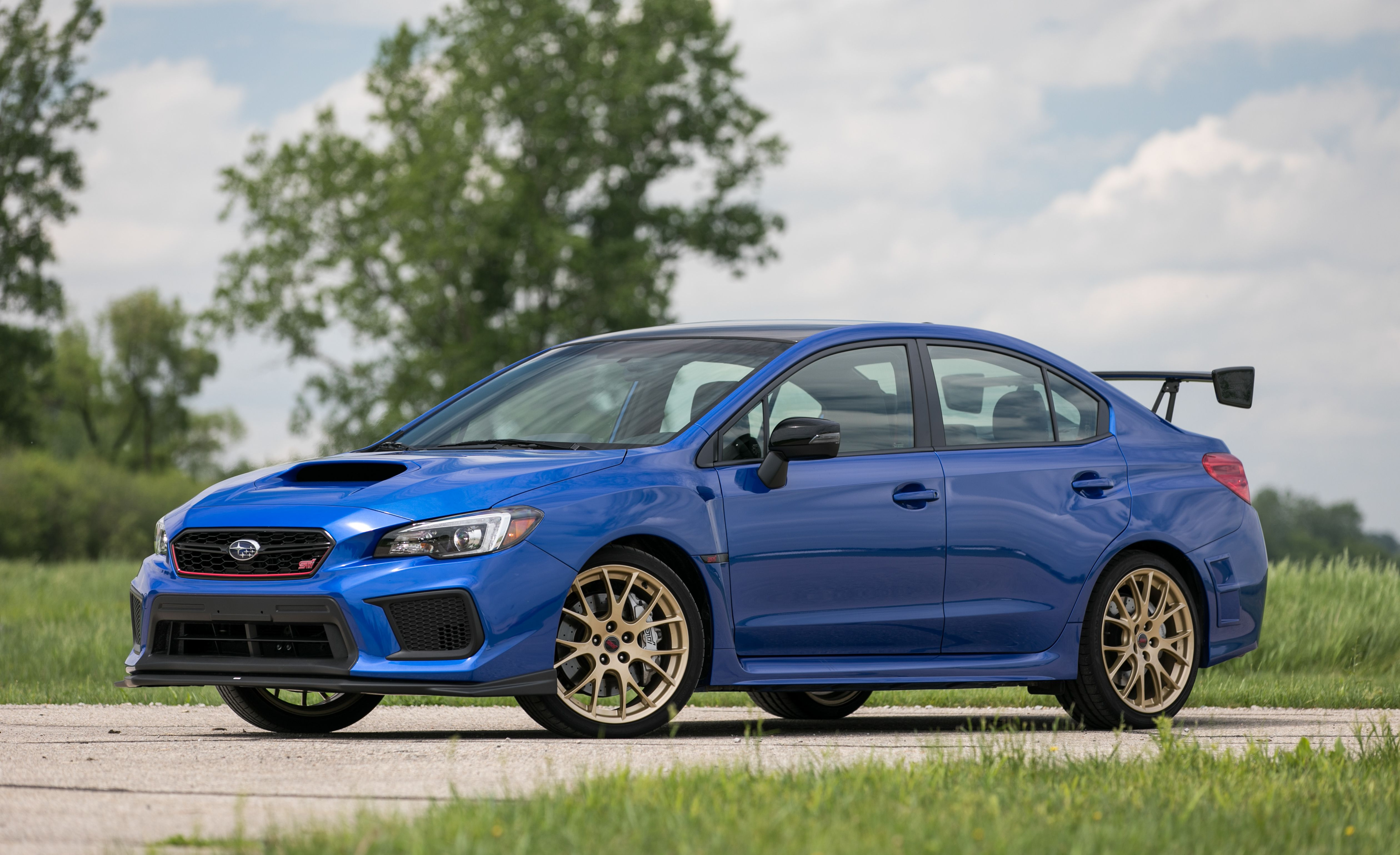 Subaru Wrx Sti Reviews Price Photos And Specs Car Driver