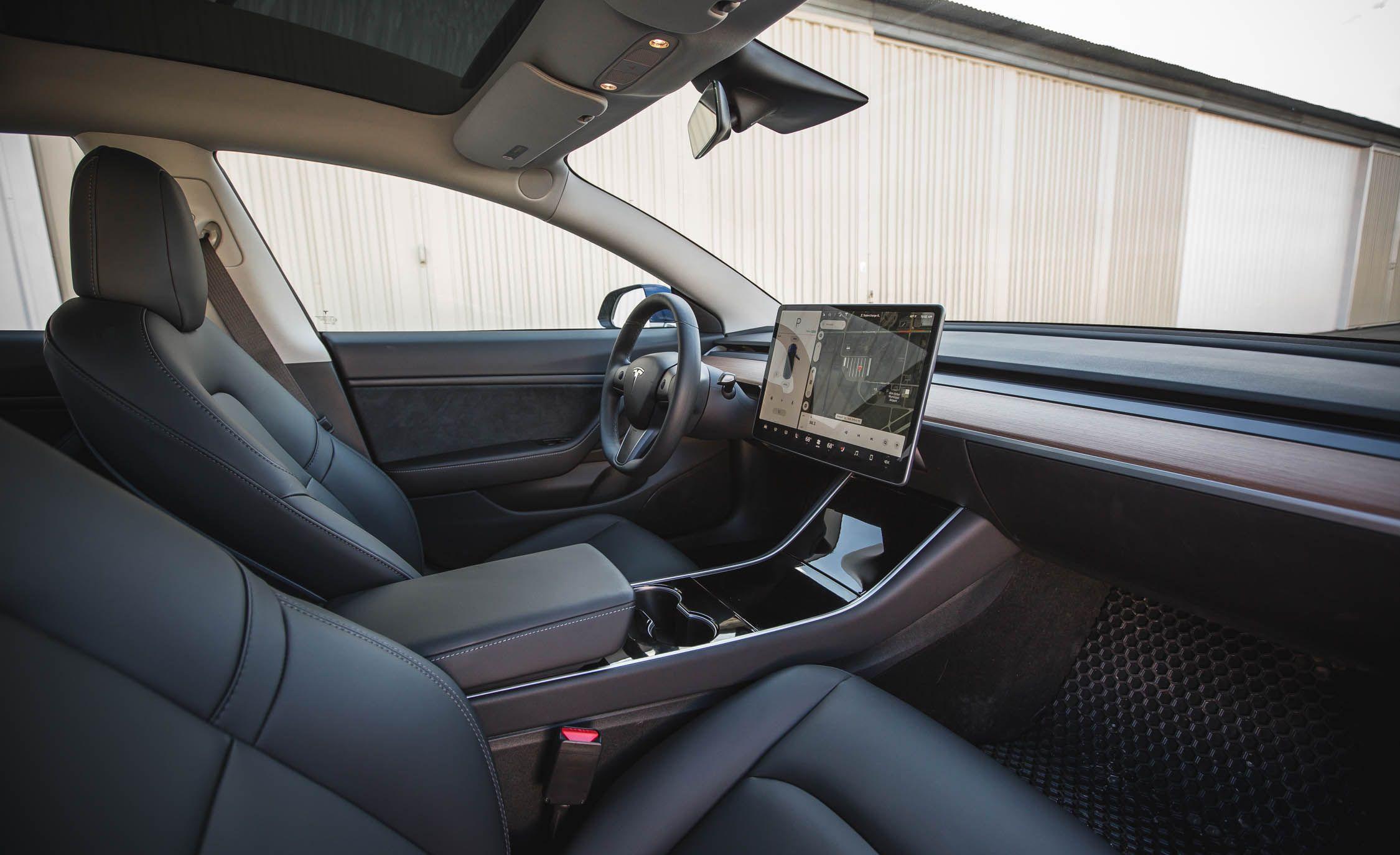 2018 tesla model 3 interior and passenger space review car and driver. Black Bedroom Furniture Sets. Home Design Ideas