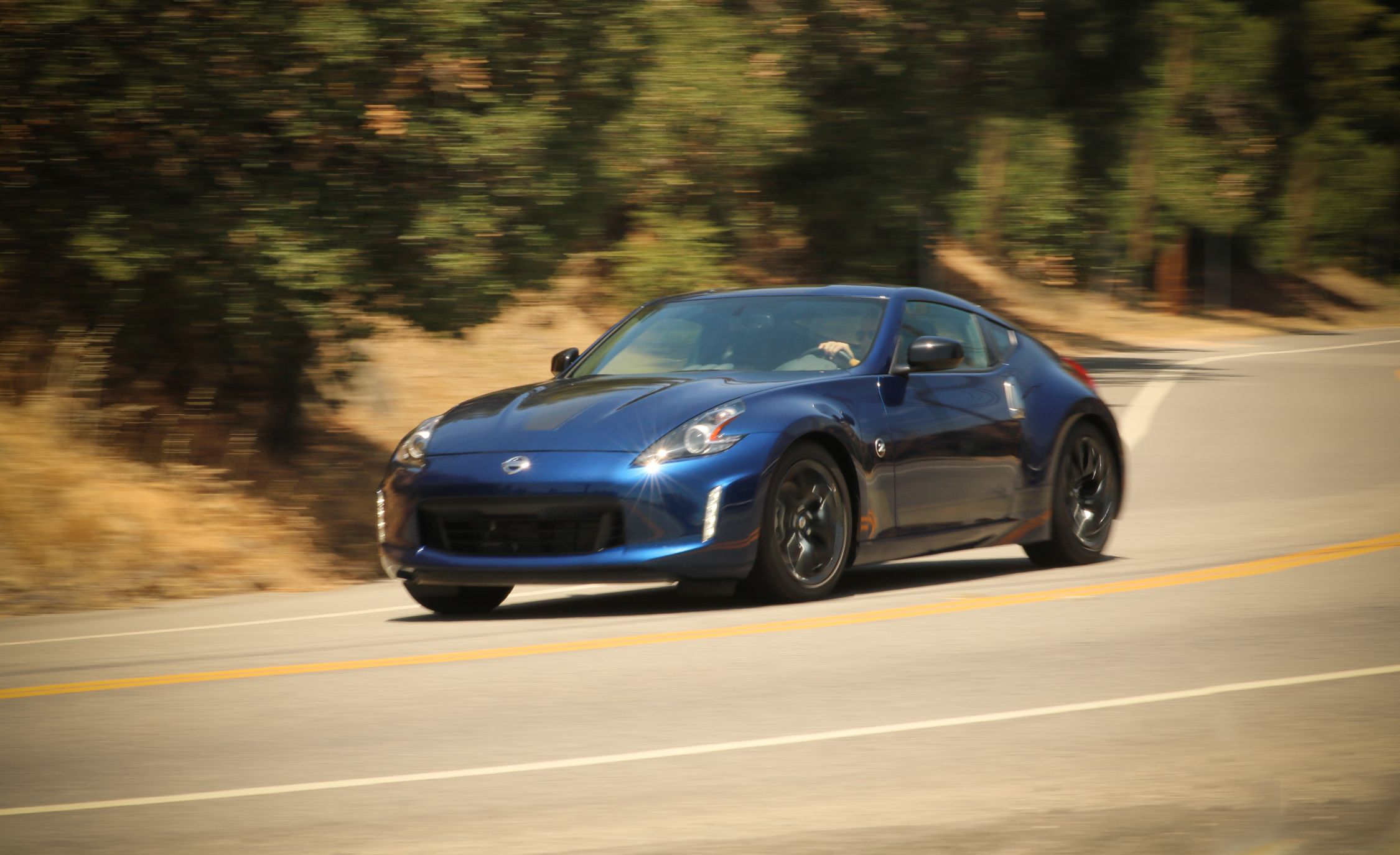 Nissan Z Reviews Nissan Z Price Photos And Specs Car And Driver