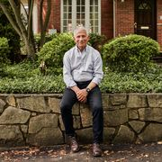 dr anthony fauci outside of a brick house
