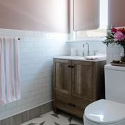 pink bathroom, white subway tiles, dusty pink painted walls, wooden bathroom cabinets, silver faucets