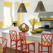 Furniture, Room, Countertop, Yellow, Kitchen, Interior design, Orange, Property, Table, Floor,
