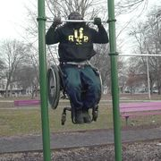 man in wheelchair does 15 pullups