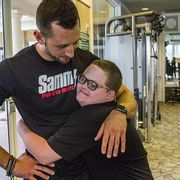 teen with down syndrome is best friends with trainer