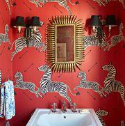 Red powder room in ScalamandreZebra wallpaper