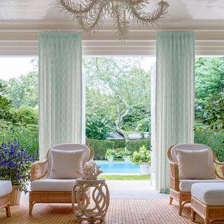 Curtain, Living room, Room, Interior design, Window treatment, Furniture, Green, Window covering, Property, Window,