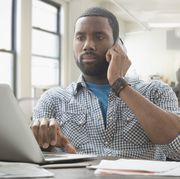 african american businessman multitasking in office