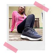 woman in pink hoodie wearing allbirds dasher sneakers outside