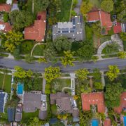 overhead shot of houses on a curved street