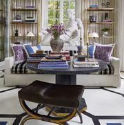 living room, gray round coffee table, coffee table books, white sofa