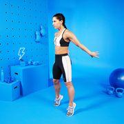 female trainer doing calf raises in a studio